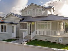 Resene Grey Friars is the perfect roof colour for this house. The weatherboards are Resene Half Tapa and the trims are Resene Quarter Sea Fog.