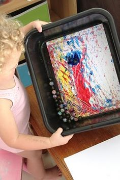 Marble painting - totally did this when I was a kid!