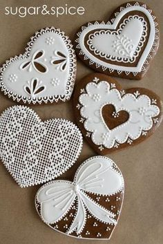 Cross-stitch and lace gingerbread hearts by Eva0707