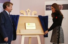 The Duchess of Cambridge unveils a plaque during her visit to The Nelson Trust Women's Centre