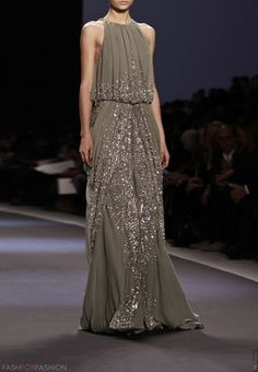 I'm thinking mother of the bride (just in a different color) by Naeem Khan