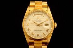 Rolex Day-Date in 18k Gelbgold (ca. 1991)  Borke Band, Ivory Zifferblatt, Römische Indexe, Gelbgold Lünette in Borke  Referenz: 18248   N-Serie   Ø 36 mm  http://www.juwelier-leopold.de/uhren/rolex/day_date.html