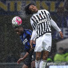 Geoffrey Kondogbia of #InterMilan competes for the ball with Juan Cuadrado of #Juventus during their #rain-soaked #TIMCup match at Stadio Giuseppe Meazza #SanSiro in #Milan #Italy | March 2 2016 | #: Marco Luzzani | #GettySport #SerieA #Juve #Inter # by gettyimages