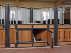 These clever stall fronts are angled, creating a space for storage. Beautiful AND smart! ~~~~~ Brilliant ideas for equestrian life at barngenius.com