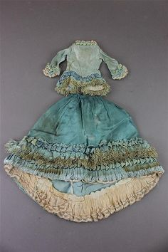 """LOT OF ANTIQUE DOLL DRESSES INCLUDING FASHION DRESSES. TURQUOISE FASHION DRESS IS POSSIBLY FOR AN 18"""" FASHION DOLL."""