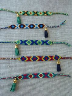 Friendship bracelets with suede tassels by SofiMoukidouJewels, $17.00...Love anything with tassels!
