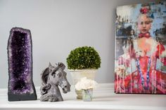 Couple transforms a townhouse into style star - Houston Chronicle On top of the fireplace is an amethyst geode from Brazil, a horsehead paperweight, plants brought from Los Angeles and a painting by Rimi Yang.  Photo: Michael Paulsen, Staff / © 2013 Houston Chronicle