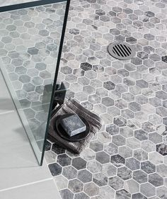 We are keen on hexagonal mosaic tiles for the shower floor and walls. Or just walls or just floor. Shower Floor Tile, Bathroom Floor Tiles, Grey Tile Shower, Toilet Tiles, Shower Niche, Shower Pan, Hexagone Tile, Casa Top, Topps Tiles