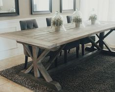 This gorgeous 108 inch trestle table was handmade and finished with a gray and Jacobean stain combined with a gray wash. Bread boards are a charming addition to the end of the table top. Size and color can be customized as well as the top (with or without bread boards) and the middle boards on the base are optional as well. Size: 108 in x 44 in x 30.5 in Shipping is not included in the list price, please message me for details. Pick up in the Austin, Tx area.