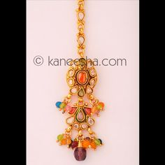 Multicolor Goldplated Headpiece Tikka Price: Usa Dollar $19, British UK Pound £11, Euro14, Canada CA$21 , Indian Rs1026.