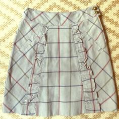 "Anthro Edmye & Esyllte Plaid A-Line Skirt Oh so adorable Anthropologie skirt by Edmye & Esyllte. I bought this as a gift and it didn't fit her :(. Size 0 or XS. POWDER BLUE/grey, red, blue and moss green adorable plaid skirt with button and ruffle detail on left front. It measures 13"" across the front at the waist while lying flat, 18.5"" from middle top to bottom. Anthropologie Skirts A-Line or Full"