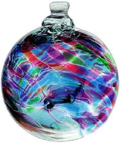 "Kitras Art Glass still honors the old world tradition of glass blowing with studios in Canada. The 2"" Birthstone Ball ornament is typical of their design, featuring tree trunk style threads inside the"