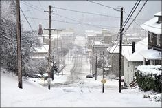 https://flic.kr/p/5MoF4L | in astoria, they don't plow the streets, they just close them. | Looking down 8th Street out to the Columbia River. The neighborhood kids use this hill for sledding. View Large On Black