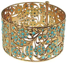Persian antiquities bracelet:    22 karat gold solid bracelet with open fretwork of a floral leaf design with turquoise beads. Probably belonged to a Queen.   200 BC