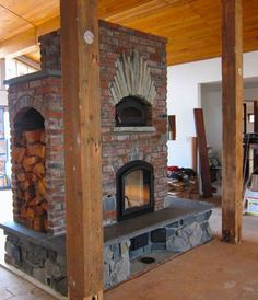 Masonry Heater - see through firebox, bake oven, three-sided heated bench, and wood storage. Masonry heaters have channels inside that absorb much more heat and radiate it into the room over a longer period of time. Cabin Homes, Log Homes, Home Fireplace, Fireplaces, Four A Pizza, My Dream Home, Future House, House Plans, Brick