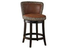 The Lisbon swivel bar stool features leopard print fabric material on a 360° swivel seat with a black wood frame.