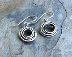 Nice little pair of sterling silver nest earrings. These earrings measure 1 from the top of the sterling silver ear wire. I design and make all