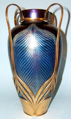 Loetz and Osiris art nouveau vase c1900. Peacock feather decoration in petrol blue on a purple iridescent ground.