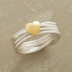 LOVE LINES RING - Coils of sterling silver line up and capture a heart, cast in brass, in a ring you'll love for life. Exclusive. Whole sizes 5 to 10.