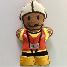 Cute little felt Gingerbread man dressed in scuba fabric wet weather gear and yellow vinyl wellies. #lifeboat #lifesavers #crew #nautical #christmasdecor #retirement #holidayhome Gingerbread Man Decorations, Funky Cushions, Baby Banners, Wellies Boots, Knit Baby Booties, Scuba Fabric, Work Gifts, Dog Bag, Felt Baby