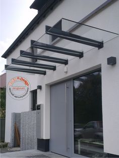 """Stainless steel brackets for glass canopies from our own production – everything """"Made in … - Eingang Dekorieren Porch Canopy, Stainless Steel Brackets, Hotel Canopy, Covered Walkway, Balustrades, Canopy Architecture, Loft Interiors, Modern Pergola, House Front"""