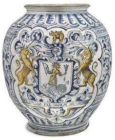 A London Delft armorial apothecary jar, 1656, Southwark, Pickleherring Quay, painted with the arms of the Worshipful Society of Apothecaries with the motto 'OPI FER QVE PER ORBEM DICOR 1656' below.