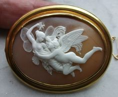 "Cupid and Psyche. Material: Sardonyx Shell, 18k gold tested.  Size: just over 2 1/8"" by just over 1 6/8"". Only cameo is 1 6/8"" by 1 3/8"".  Date and Origin: Circa 1860 Italy.  Saulini"