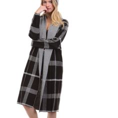 Black plaid cardigan sweater Brand: Tea n Cup, Material: 60% cotton, 40% acrylic. One size fits most. Great quality, comfortable and warm. Hat not included. Tea n Cup Sweaters Cardigans