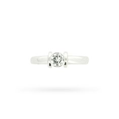 Thissleek and streamlined diamond solitaire engagement ring in 18 carat white goldis athoroughly modern take on a classic. The ring centres a single round brilliant cut diamond in a chic minimalist rubover setting, finishingwith a slightly tapering polished shank.