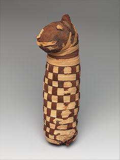 Donation mummy with dog bones, ca.400 BC–100 AD. Egypt, Western Desert; Kharga Oasis, el-Deir. Late–Roman Period | The Metropolitan Museum of Art, NY