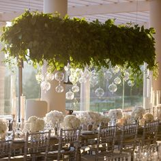 Photographer: John & Joseph Photography; Dreamy white wedding reception with hanging greenery decor