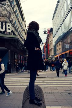 hundred&ten watches city rebel. Stockholm city center, main street, sunday morning. Our watch with casual stylisation, half long black coat, simple jeans and black shoes.