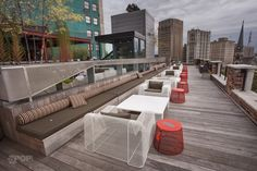Look out over Grand Circus Park while lounging in these #Coalesse Emu Ivy lounge chairs with tables and poufs to match.