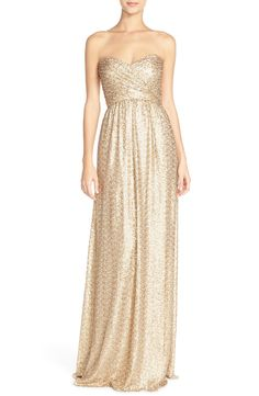 This gorgeous strapless sequin gown for the bridesmaids.