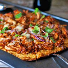 Skinny BBQ Chicken Pizza mad with a cauliflower crust- only 150 calories per slice!  I am very interested in how the crust measures up...