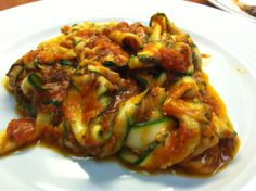 Zucchini ribbon pasta with marinara sauce  Zucchini is a low carb, no cook meal that is just as delicious as real pasta!  Wash and peel zucchini into ribbons. Cover ribbons, aka pasta, with marinara sauce. Enjoy!