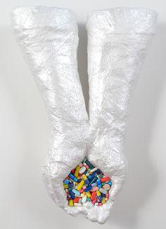 "Tina La Porta.    Medicine Ball (Study), 2012. Mixed Media on Plaster with pills, 11 x 16""."
