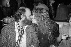 Peter Grant Robert Plant Kissing - disturbing lol...but always looking for bad attention.