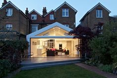 Dramatic Rear Extension with full width folding sliding doors and a huge triangular window at the gable end