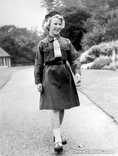 Princess Anne walking to a Brownie meeting in the gardensof Buckingham Palace. 27th November 1959