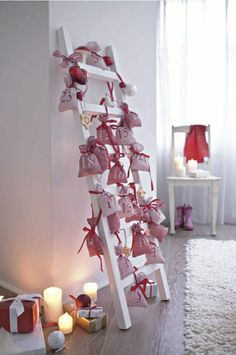 Advent calendar on a ladder. Maybe add painted clothespins to hang each bag.