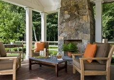 Stone outdoor fireplace..so pretty...how can we possibly put a tv on that???