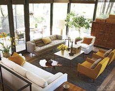 CALIFORNIA STYLE WITH AN ASIAN TWIST    DePerno designed the living room's large, white sofa, which is upholstered in a linen by Clarence House; the floors are fumed oak