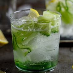 The perfect Gin & Tonic for World Gin day flavored with fresh cucumber and lemon.