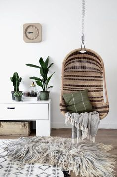 Loving the green and brown palette, mixed textures of course, the hanging wicker seat!