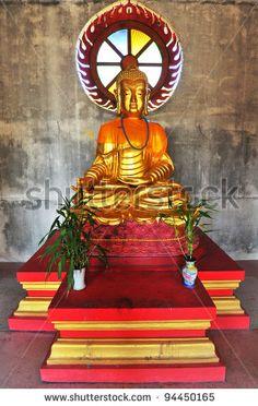 Beautiful golden Buddha, golden lord Buddha statue. by Sayanjo65, via ShutterStock
