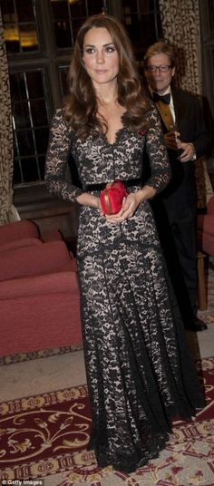This time accessorising the Temperley favourite with a red clutch bag, the Duchess chose to wear the lace gown to a dinner to mark the 600th...