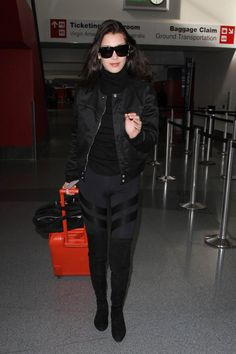 Pin for Later: 25 Fashion Lessons Every Woman Can Learn From Bella Hadid But All-Black Will Always Look Elevated Even if you're wearing casual pieces. Plus, you can add a pop of color with a bag or even your suitcase.
