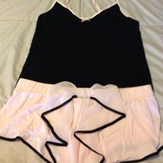 Victoria Secret pj Really cute Victoria secret cami and shorts pajamas , never been worn with tags, very soft and pretty! Really cute bow in the back, this is a 2 piece set Victoria's Secret Intimates & Sleepwear Pajamas