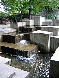 Freeway Park in Seattle combines lush landscaping with concrete containers, walls and a concrete water feature.  Photo by Charles Birnbaum:: :: The Cultural Landscape Foundation